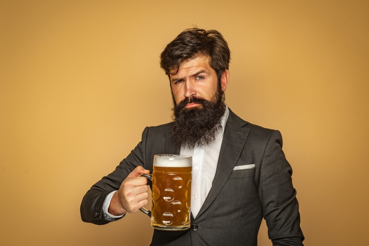 Man holding stein of beer